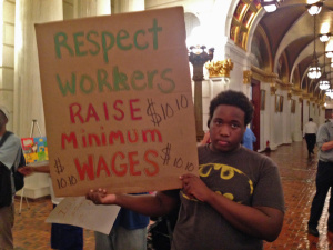 A protester urging his elected officials to respect workers by raising the minimum wage/courtesy raisethewagepa.org