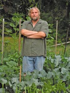 Rich standing in his garden
